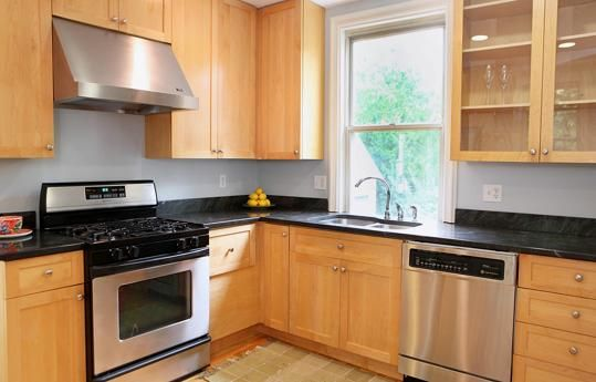The dining area leads to an updated kitchen with stainless