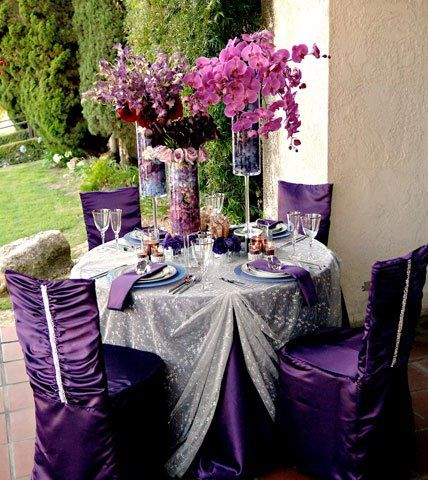 purple chair covers and silver overlays. | inspiration for a