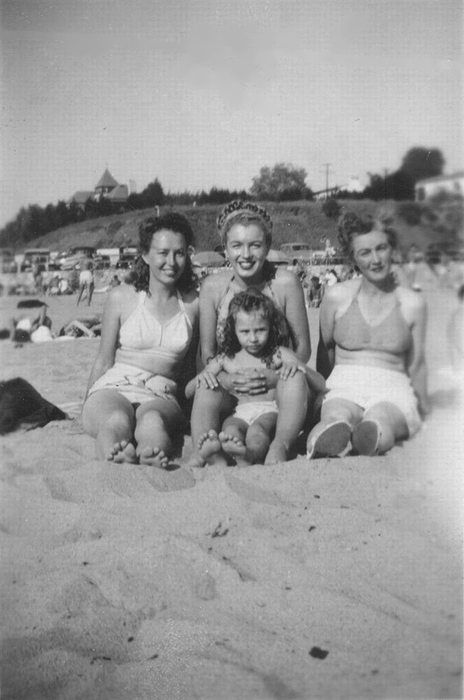 Norma Jeane (now Marilyn) holding her niece Mona Rae with Berniece (her half-sister, on the left), and her mother (on the right), 1946.