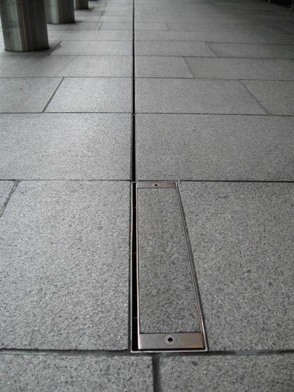 Slot drain cleanout access architectural products for Landscape channel drain
