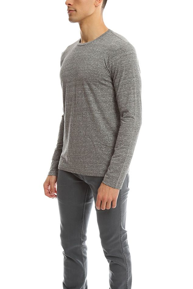 The Perfect Tee is here. Goodlife's Basic Long Sleeve Crewneck falls seamlessly on the body like every other tee wishes it would! Grab these essential closet staples as soon as you can.-Color: Light Heather -Fabric: 50% Polyester 38% Cotton 12% Rayon-Made in USA-Machine wash cold*Model is 6'1 wearing size Medium | Men's Goodlife Basic Crewneck LS Top in Blue, Size XL