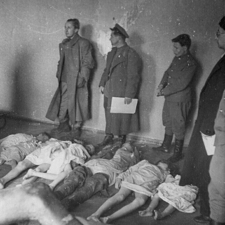 Soviet intelligence officers identifying the remains of ...