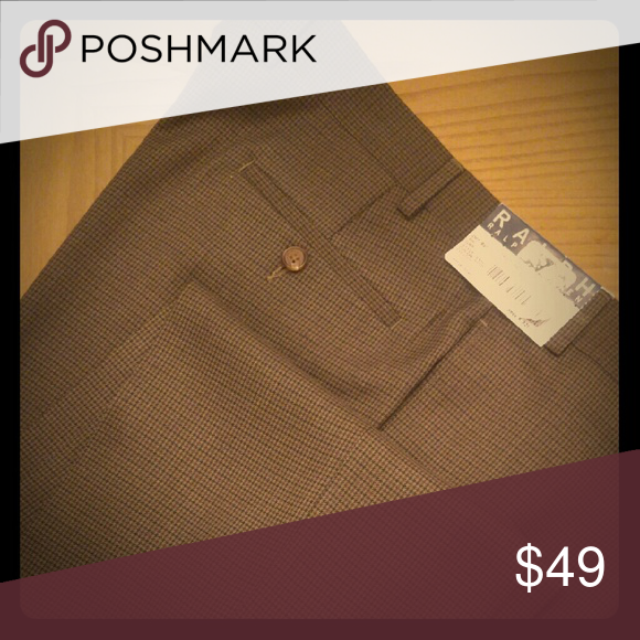 "Ralph Lauren Men's Pants Ralph Lauren Men's Pants...Modern Fit.... Size 38Wx32L...New with Tags Attached.  Why are the tags attached? Because they've NEVER been worn. These pants offer you a classic warm look, a look that's inviting...perfect for winter. You'll look Marvelous...even if you don't feel marvelous.   ""My father use to say to me...don't be a snook...it's not how you feel...it's how you look"" Ralph Lauren Pants Dress"