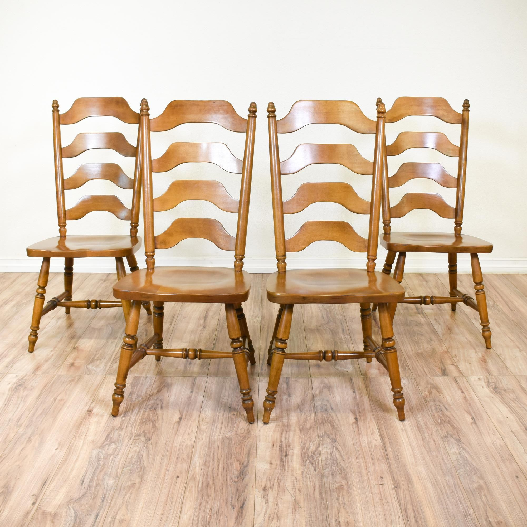 This set of 4 country chic chairs are featured in a solid wood with