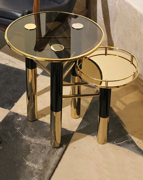 Ike side Table features a brown glass top with a gold trim three
