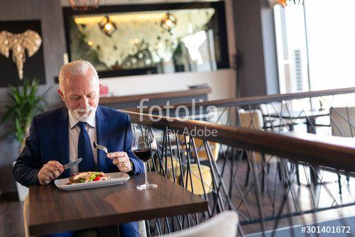 Senior businessman having lunch in restaurant