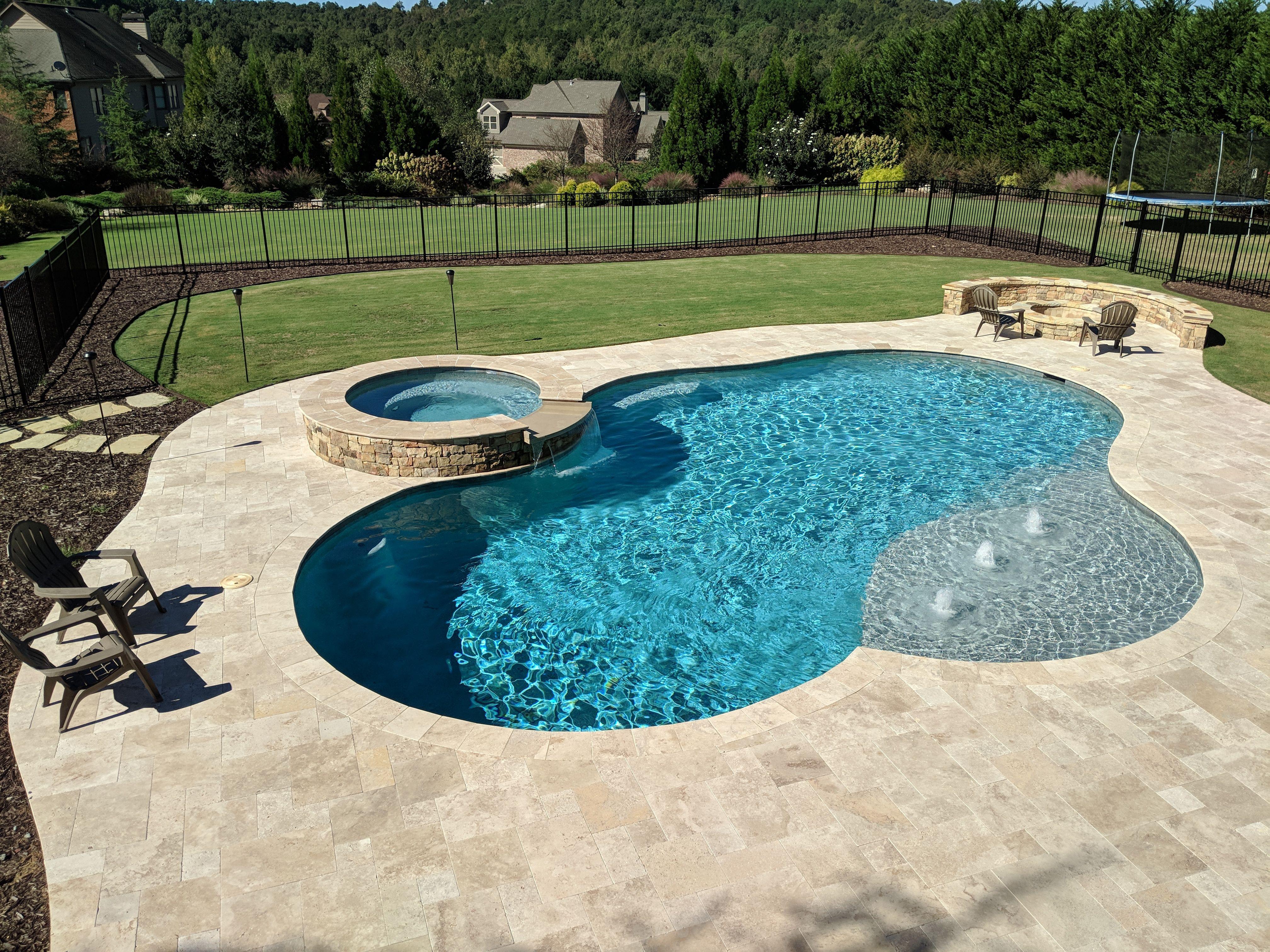 Freeform Pool With Raised Spa And Ivory Travertine Coping And Spa Custom Swimming Pool Pools Backyard Inground Backyard Pool Landscaping
