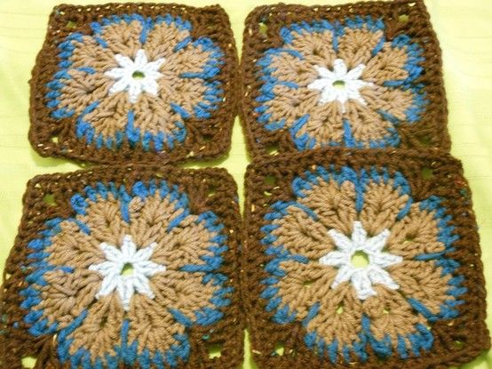 Making these modified African Flower squares for a blanket for a friend as a gift to her co-worker.  It'll be 5 squares by 5 squares. of these African Flower type squares, 4 of another pattern, and 12 of a solid color.