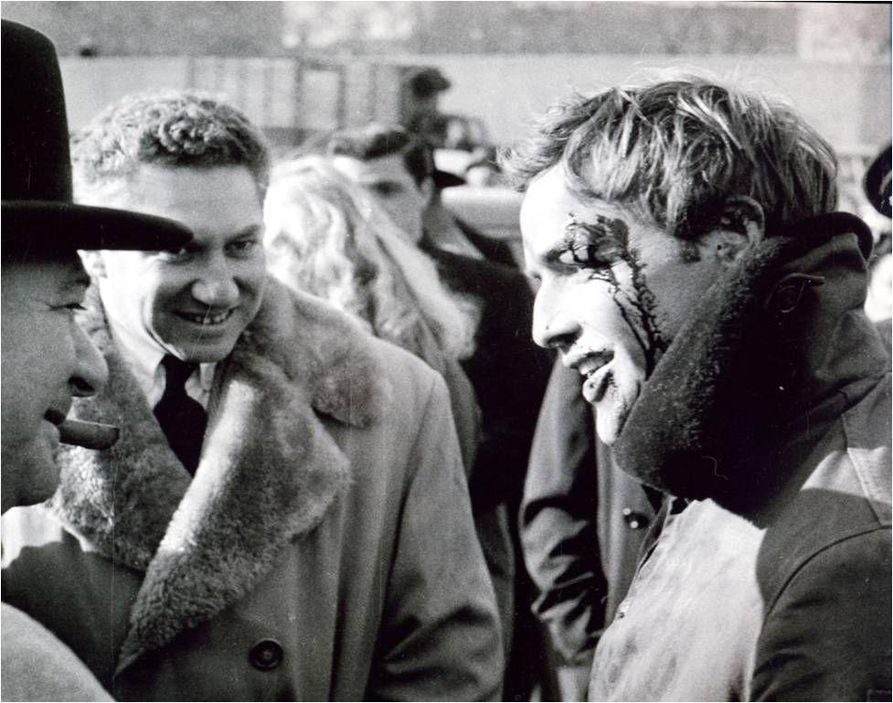 Screenwriter Budd Schulberg (center) with Marlon Brando on the set of On the Waterfront, 1954, dir by Elia Kazan.