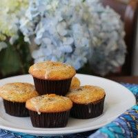 Fresh orange juice and poppy seeds make beautiful sunshiny muffins that everyone will want to wake up to eat! They also make great snacks.