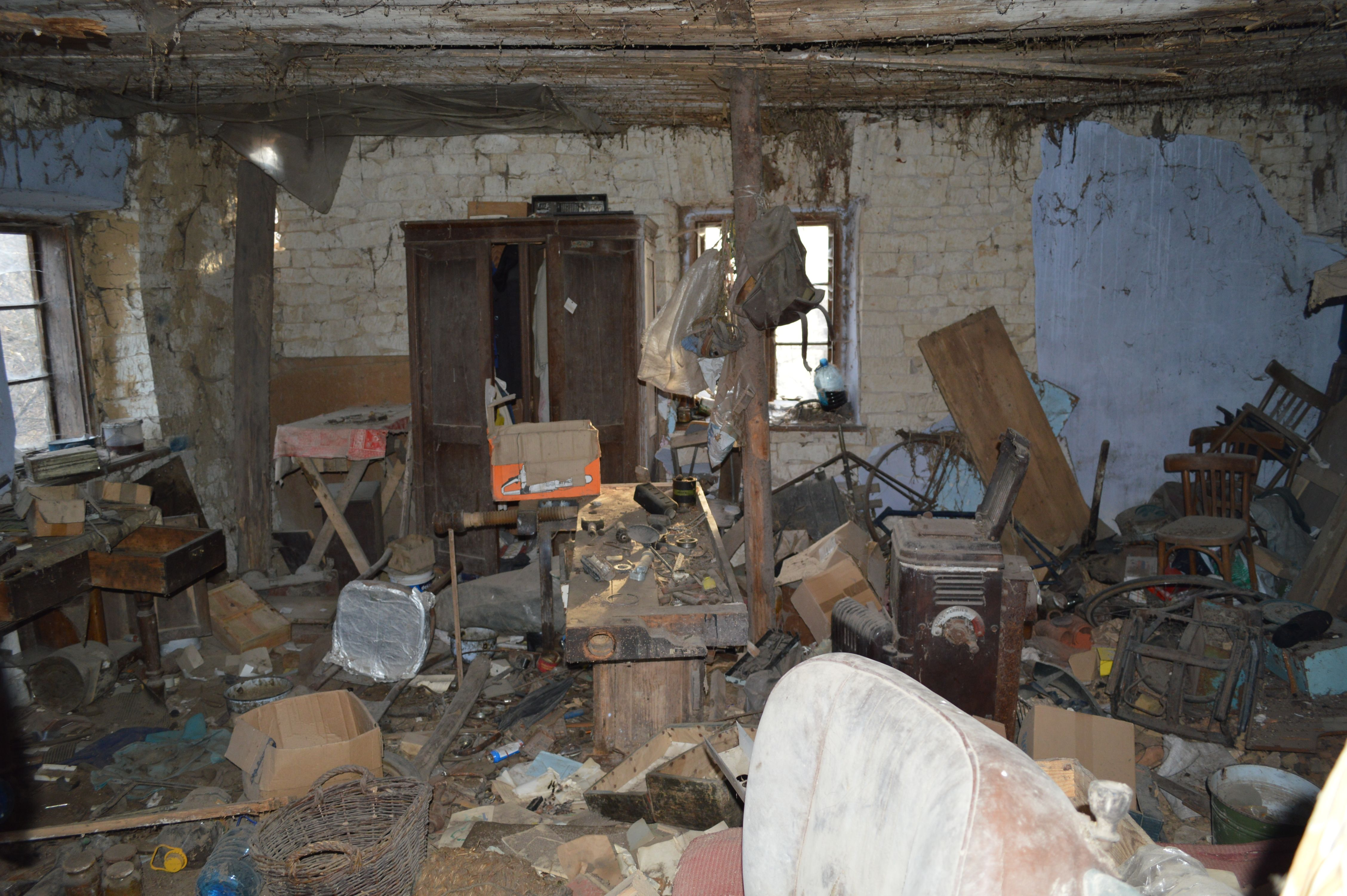 Inside the long abandoned 18/19th century brick farm house in the polish countryside...