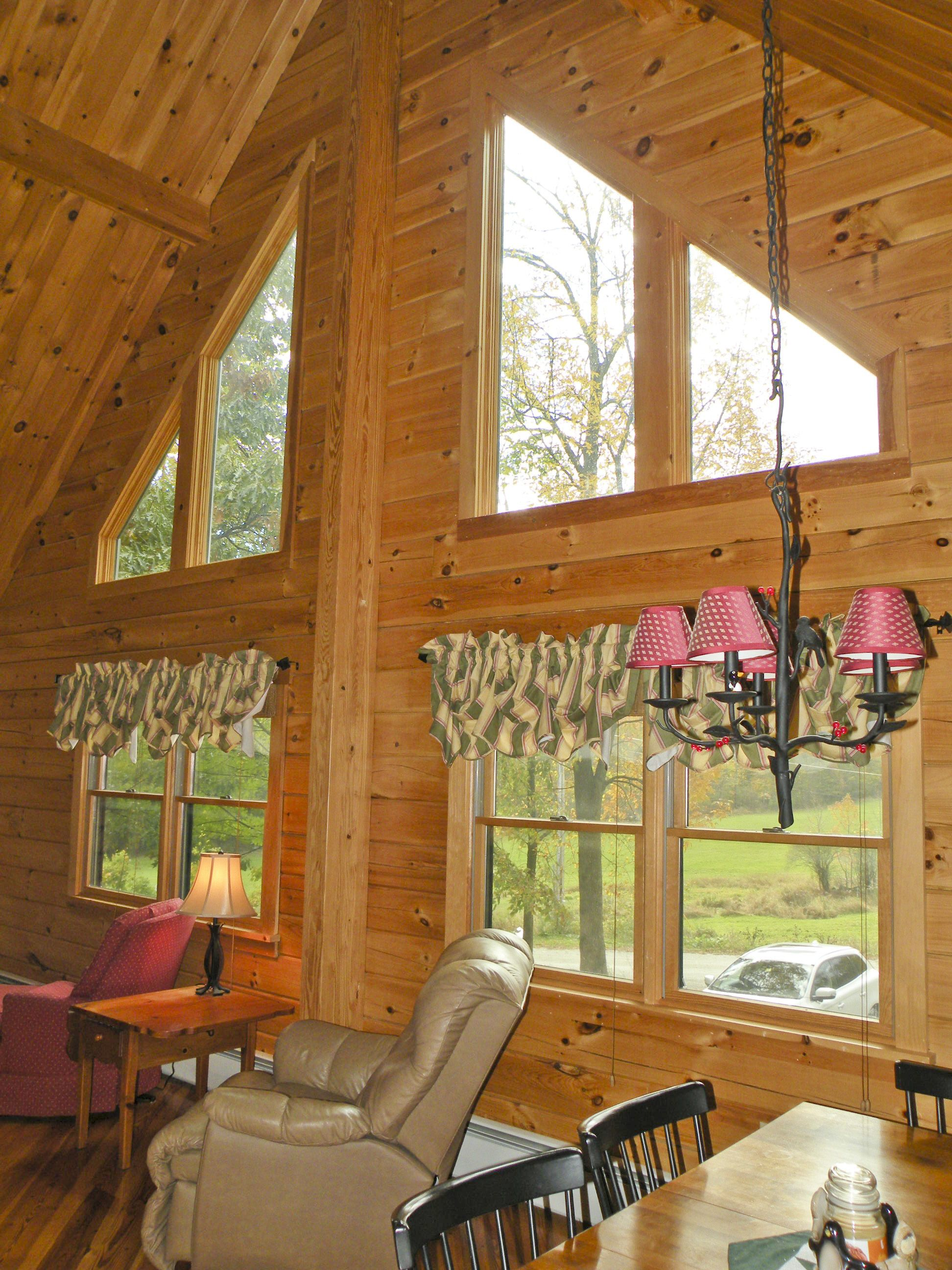 Vaulted ceiling and expansive windows for maximum natural - Vaulted ceiling designs for homes ...