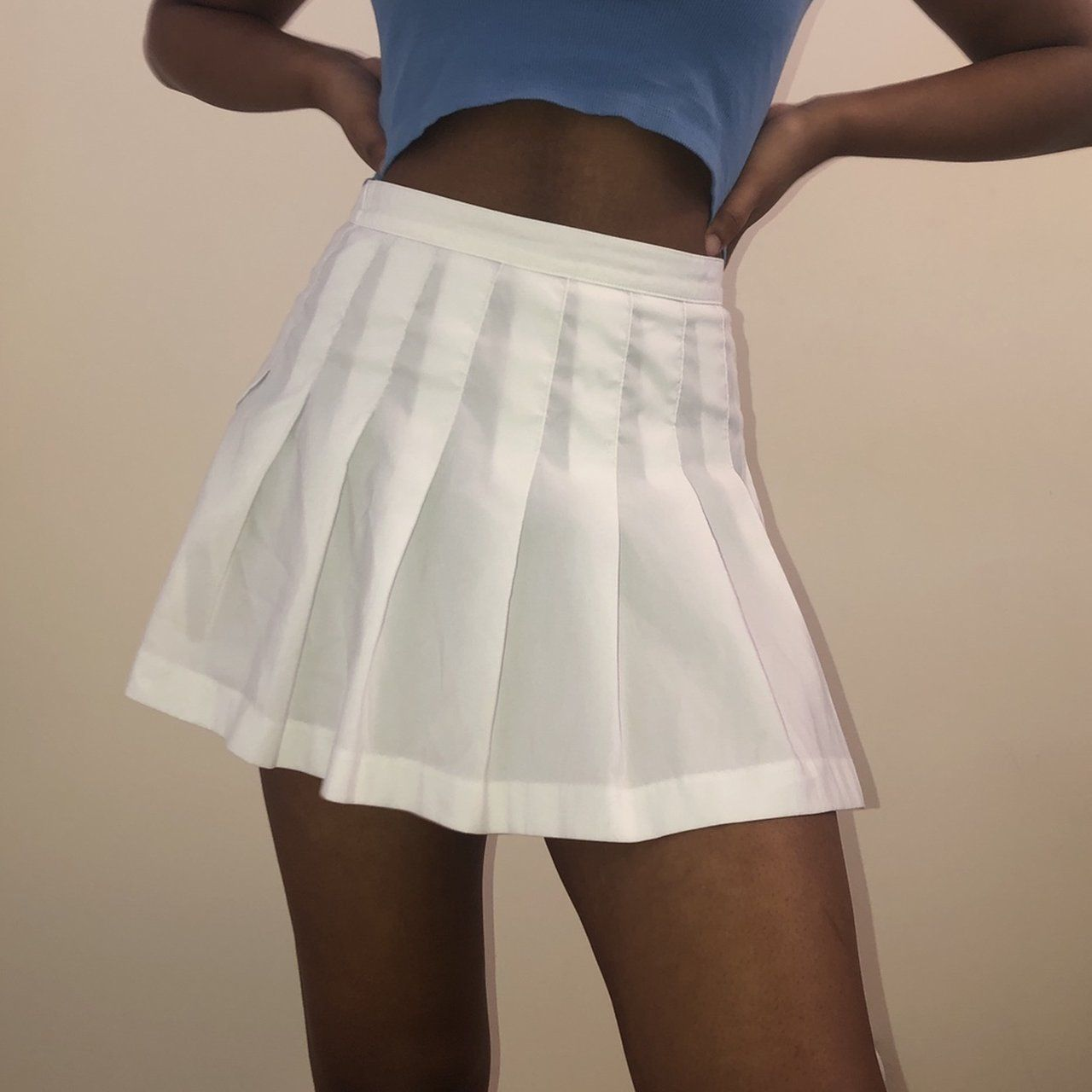 "4d2a29568e white high waisted pleated mini skirt. the brand is wilson. fits size small/medium.  26"" waist, 14.5"" length. model is 5'9.tags: tennis cheerleading school ..."