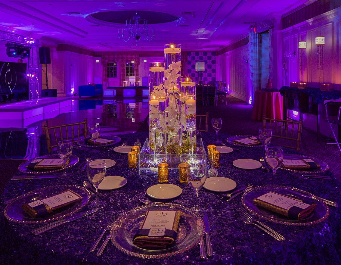 #Purple Bat #Mitzvah with #gold #sparkle and #sequin accents! The #centerpieces were cylinder vases filled with water, gold stones on the bottom, submerged #flowers in the center, and floating candles on top. Absolutely #stunning!  Designed and Pinned by @xquisiteflowers  #tablescapes #batmizvah #sweet16 #eventdecor #partyideas #batmitzvahideas #partyplanning #decor #design #eventdesign