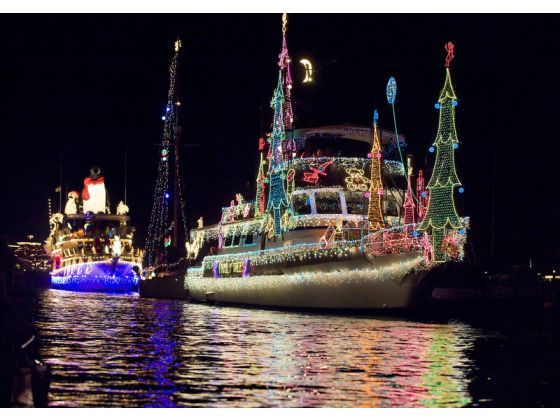 """Join over a million viewers as you watch beautifully decorated boats, yachts, kayaks, and canoes sail along the harbor in the 104th Annual Newport Beach Christmas Boat Parade. Hosted by the Commodores Club of the Newport Beach Chamber of Commerce, celebrate this year with a fun """"Surf, Sand, and Santa"""" theme! Visit www.xplorela.com"""
