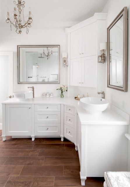 Love This Cute White Bathroom With Hardwood Floors Silver Mirrors And Corner Cabinets Bathroom Vanity Designs Corner Bathroom Vanity Bathroom Remodel Master