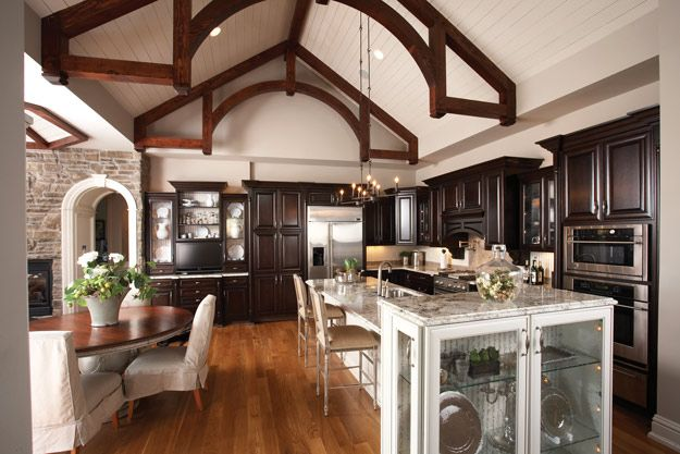 Rustic beams and high ceilings in this kitchen ranch for Open beam house plans