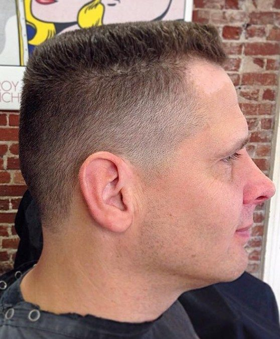 High and tight skin fade with a fanned pompadour t