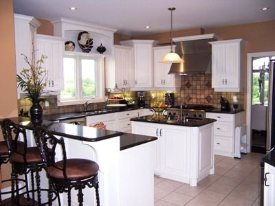 kitchen ideas for brown walls, black appliances and white cabinets