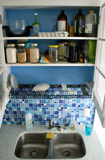 wire rack above sink = dish drying rack