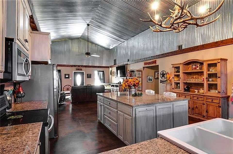 Corrugated Tin Dominates This Remarkable Kitchen In A Small Barndominium Barndominium Interior Barndominium Metal Building Home