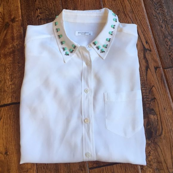 Equipment 100% silk blouse with embellishments Gorgeous silk blouse with pretty embellishments at collar. New with tags. Excellent condition no rips or stains Equipment Tops Blouses