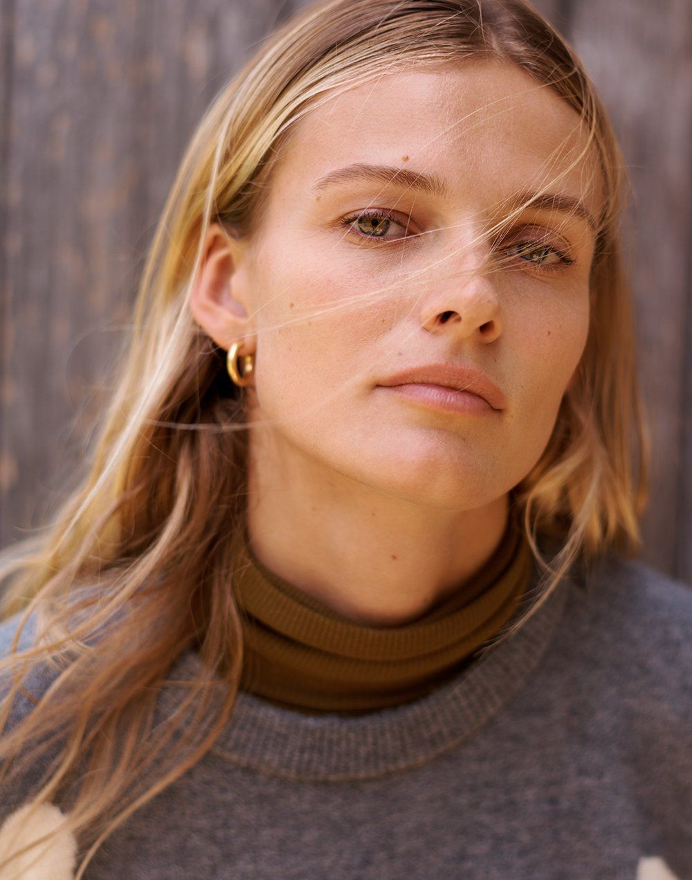 4c7522192 madewell chunky small hoops worn with fine ribbed turtleneck top + heart  dot pullover sweater.