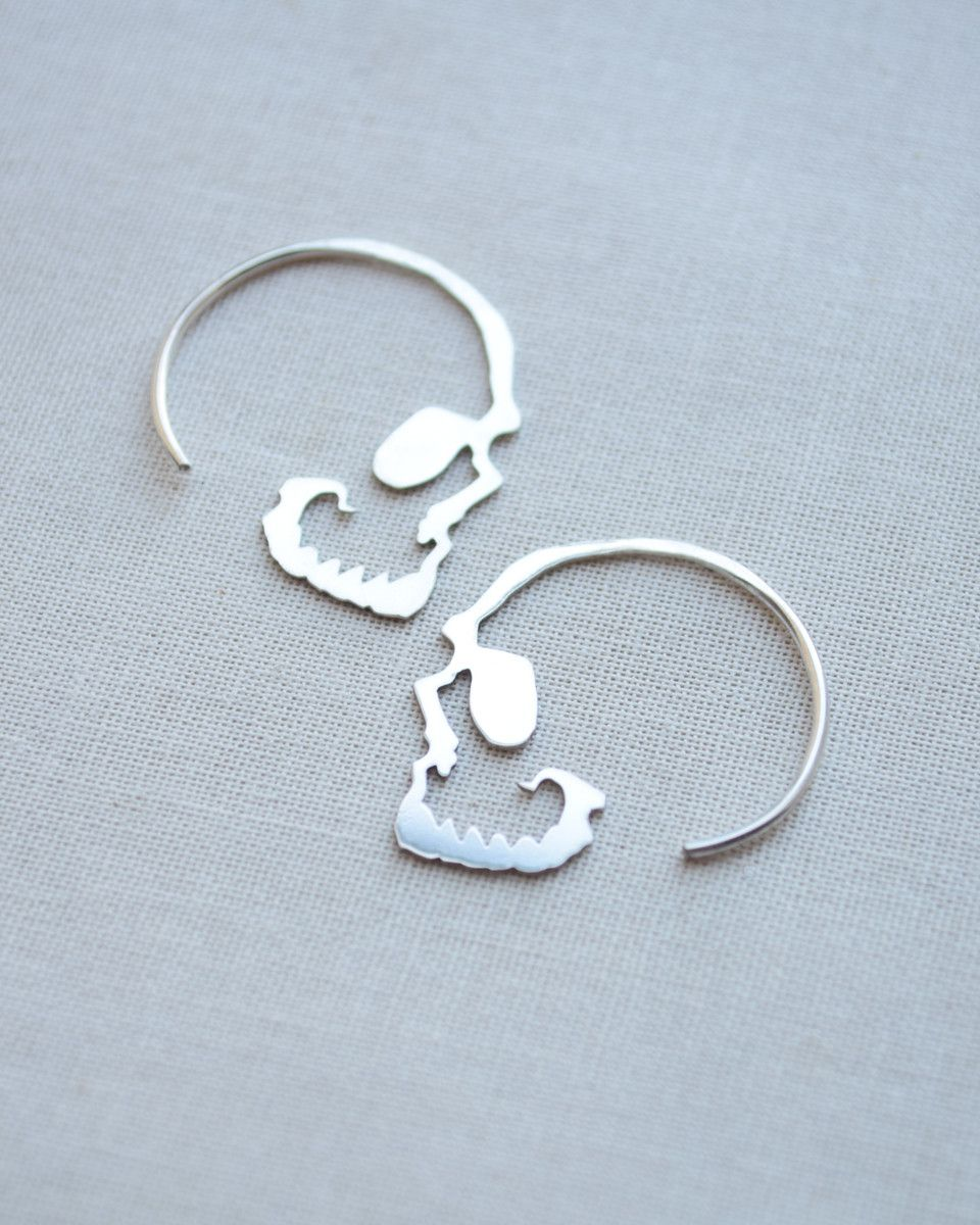 Our silver skull hoop earrings are the perfect accessory with a ...