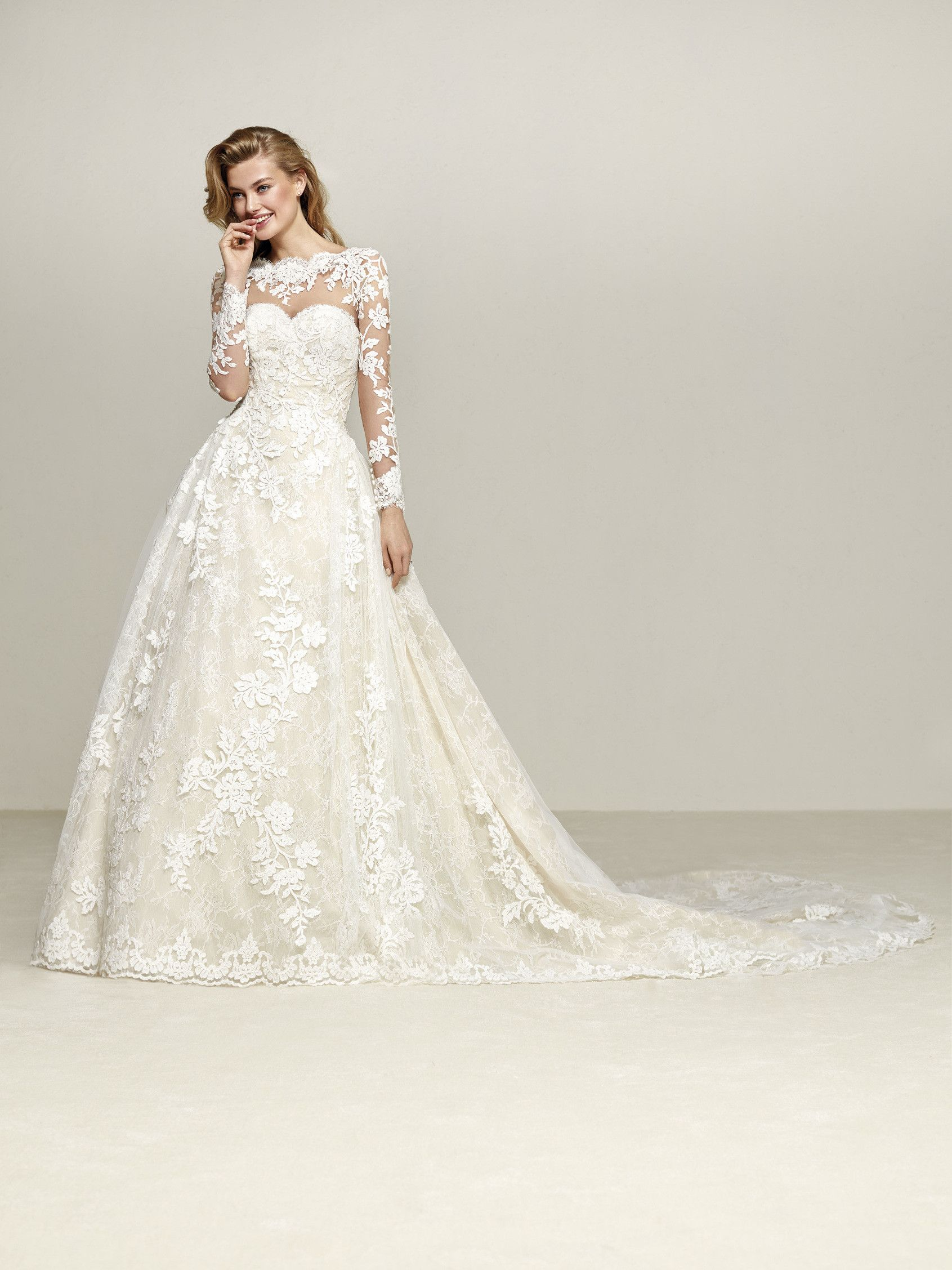 Drumsa is a magical wedding dress with long sleeves