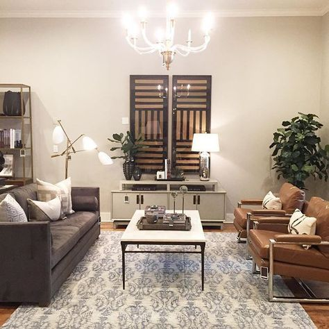 Alice Lane Home Collection Black And Gold Art Gray Sofa Paired With Cognac Leather Chairs Grey Sofa Living Room Glamour Living Room Living Room Grey