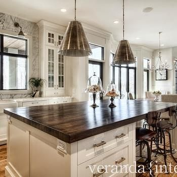 Dark Butcher Block Island Countertop With White Cabinets To