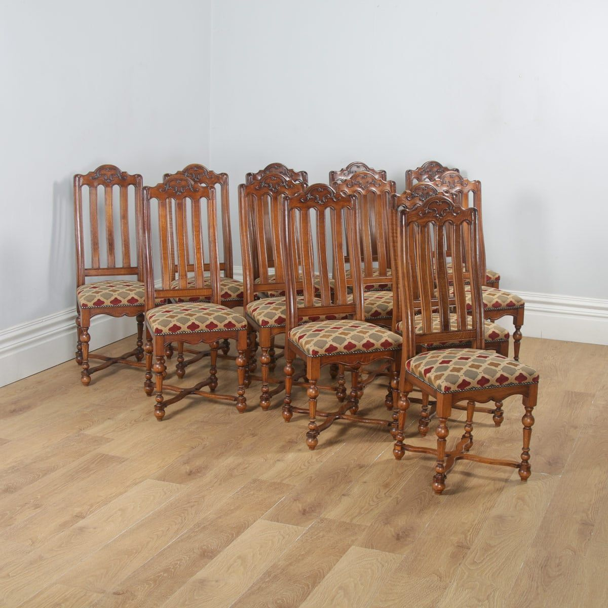 Antique set of twelve belgian louis style oak