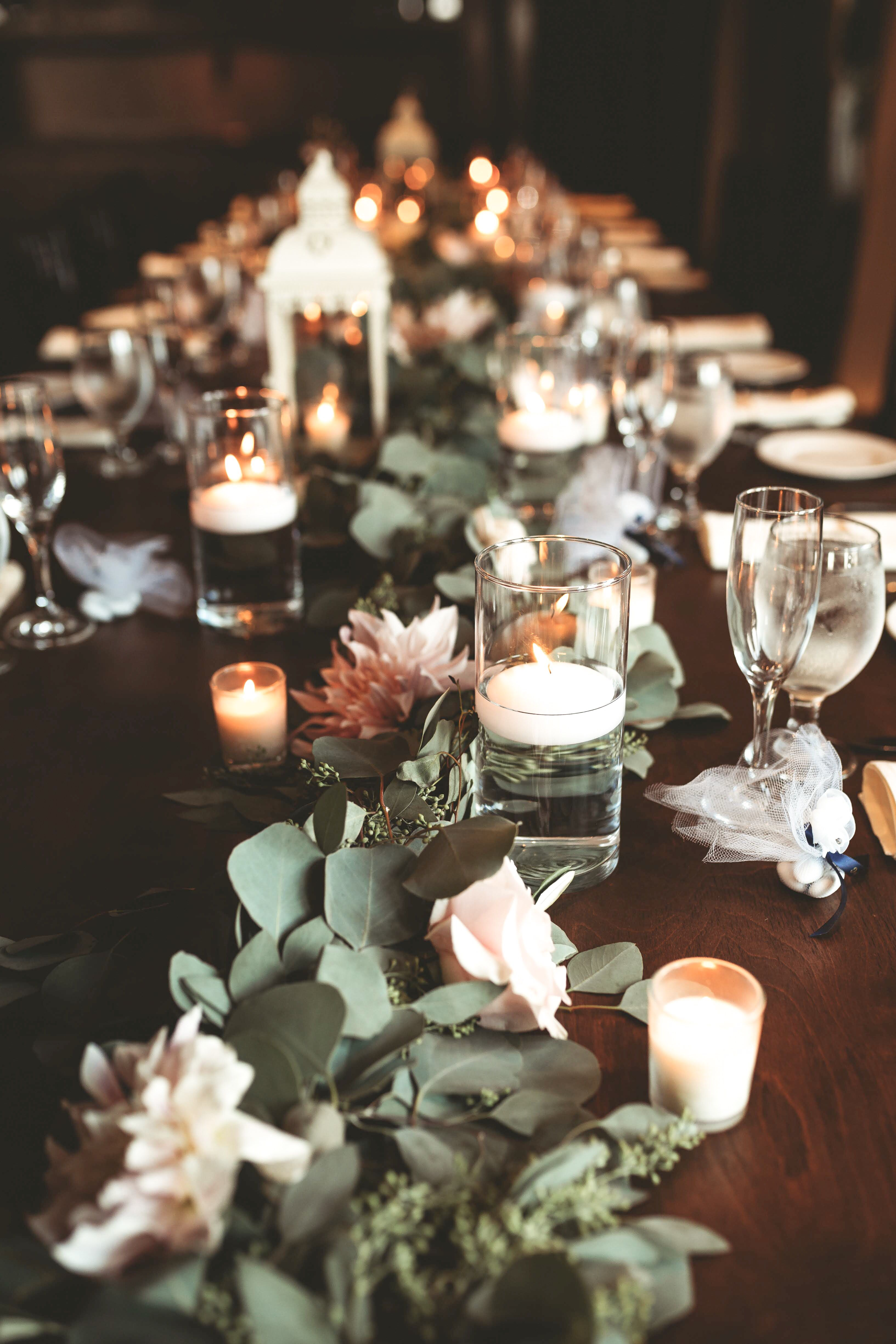 Garland On Table At Wedding With Floating Candles Floating