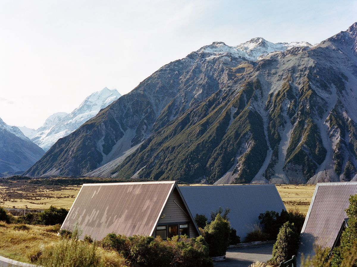 At The Base Of Mount Cook In New Zealand Our Contributor Mary Gaudin Found These Chalets Part Of A Motel Bu The Places Youll Go Beautiful Places Places To Go