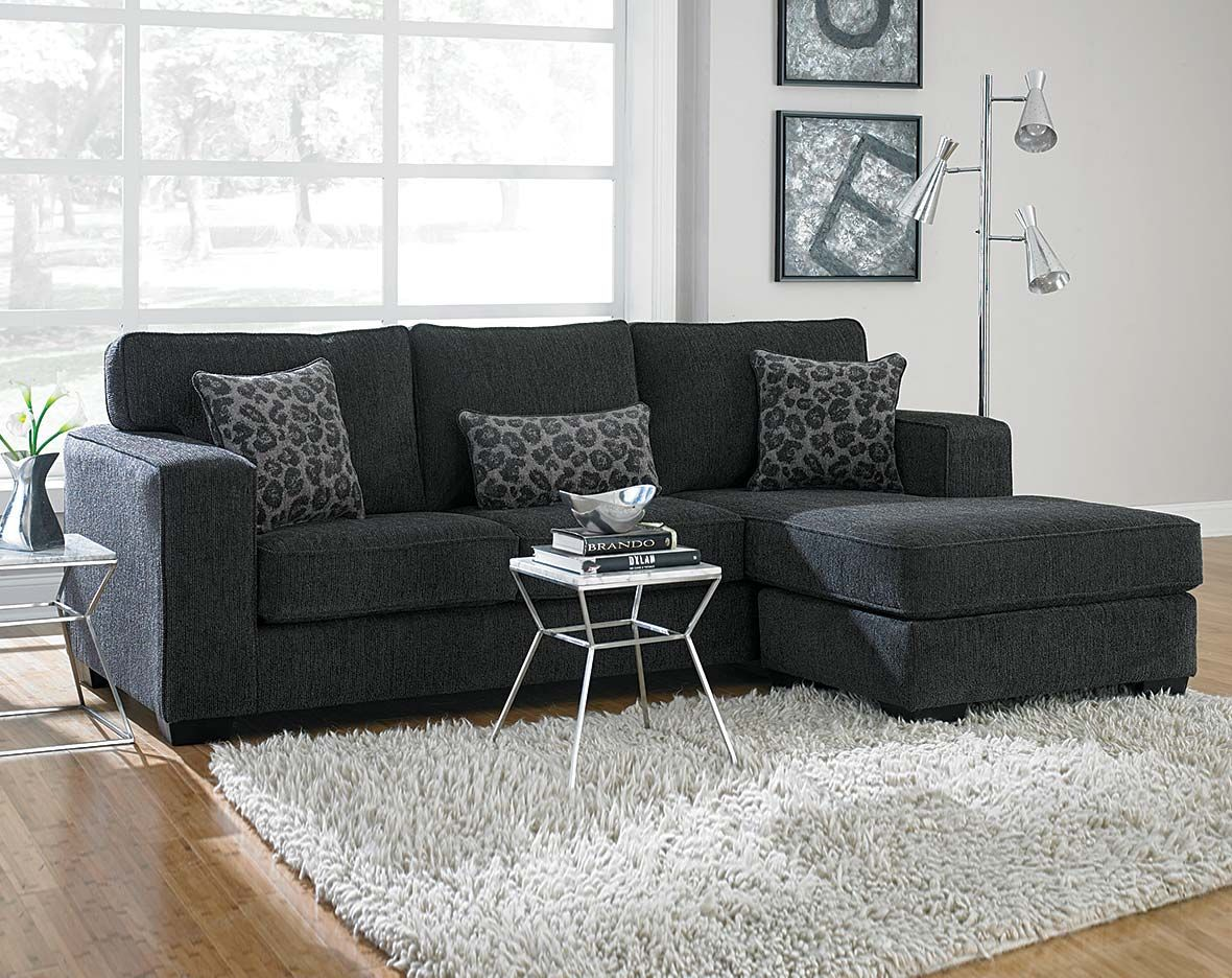 This dark gray sectional sofa is covered in a soft for Gray living room black furniture