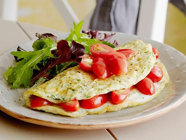 Keep dinner quick and light with this Herbed Egg White Omelet with Tomatoes that's ready in just 14 minutes.