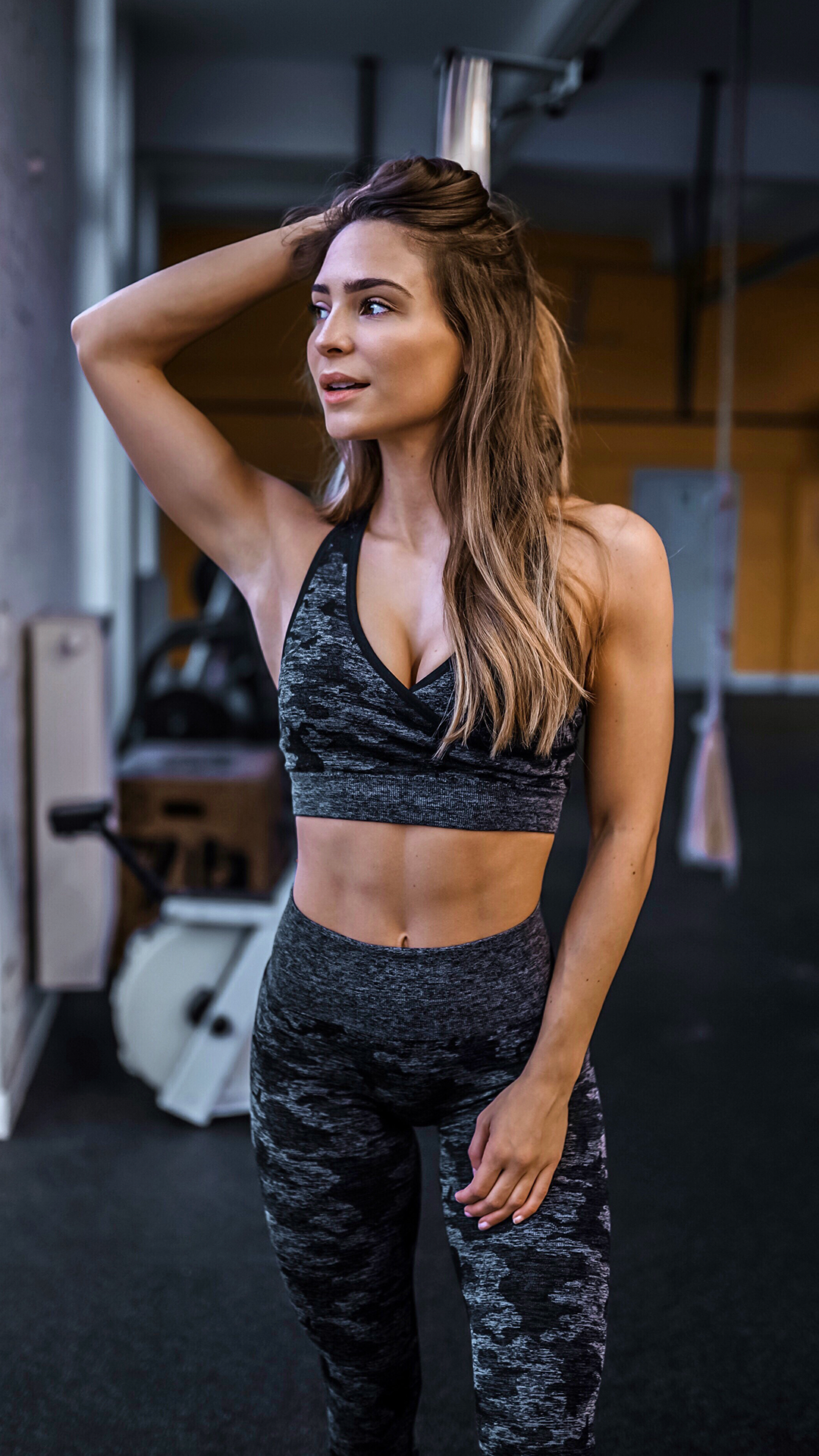 55059c6c7014d Evelina sports the Camo Seamless Sports Bra and Leggings in the Black. A  camouflage pattern, designed to blend out. The Camo Seamless Leggings are  what ...