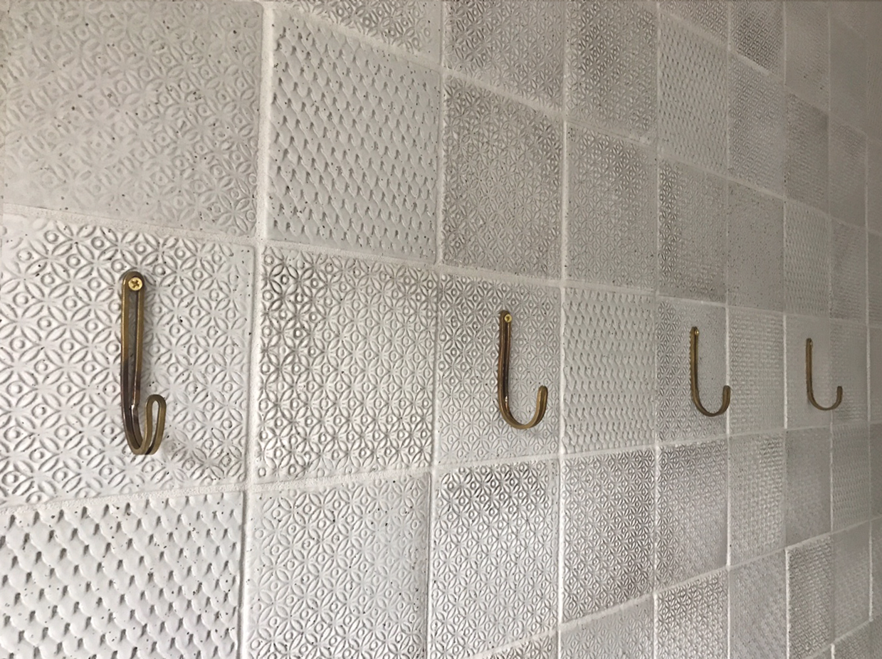Our customers in California used our Dove House and Whitechapel Handmade tiles on the wall of their utility to room, to create this unique, tactile finish.