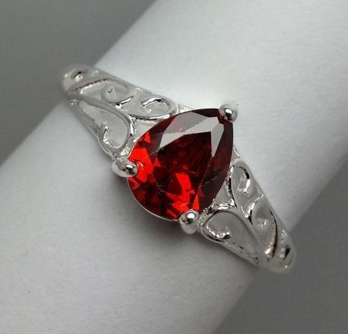 Stunning-Red-Teardrop-Rhinestone-Costume-Ring-on-Fancy-Silvertone-Band-Size-8-25