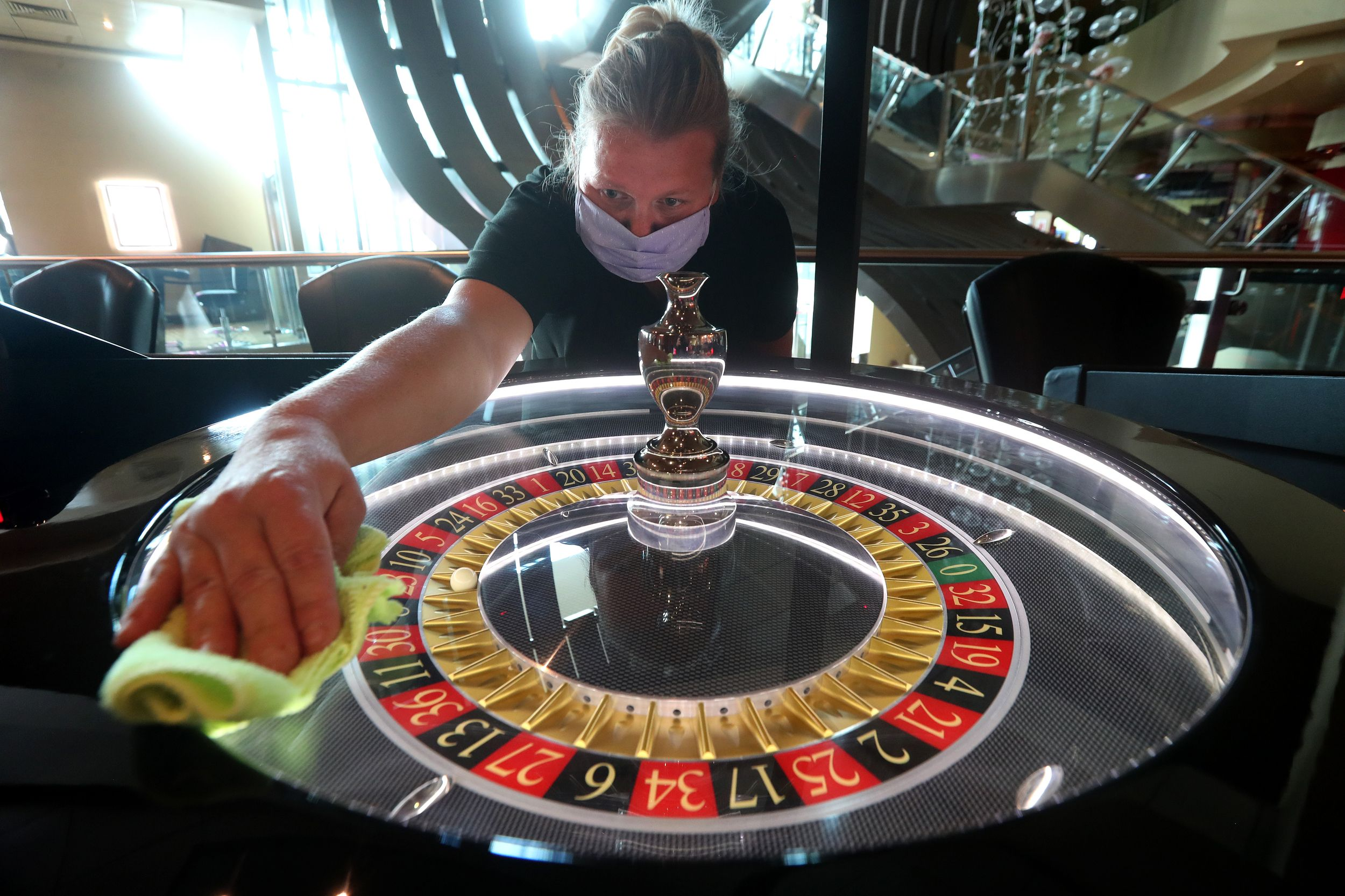Monika Bednarska cleans the electronic roulette table