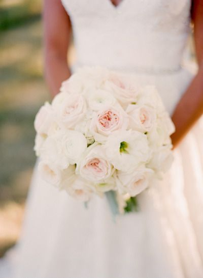 a clutch bouquet of ivory patience garden roses cream hydrangeas blush ohara