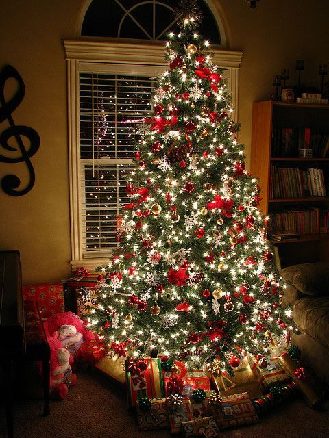 Christmas Tree With Red Decorations And White Lights Beautiful