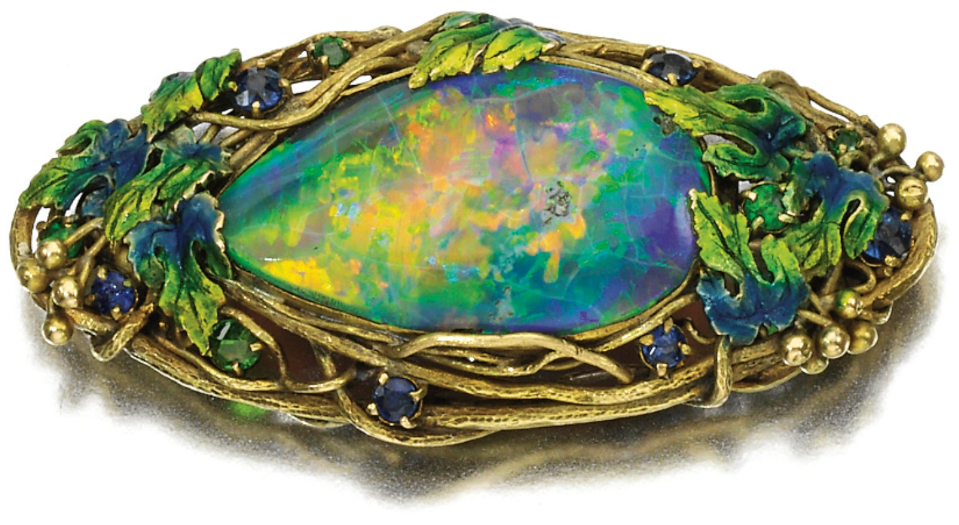 e554a2f68 Art Nouveau opal, sapphire, garnet, and enamel brooch by Louis Comfort  Tiffany for Tiffany & Co., circa 1910. Via Diamonds in the Library.