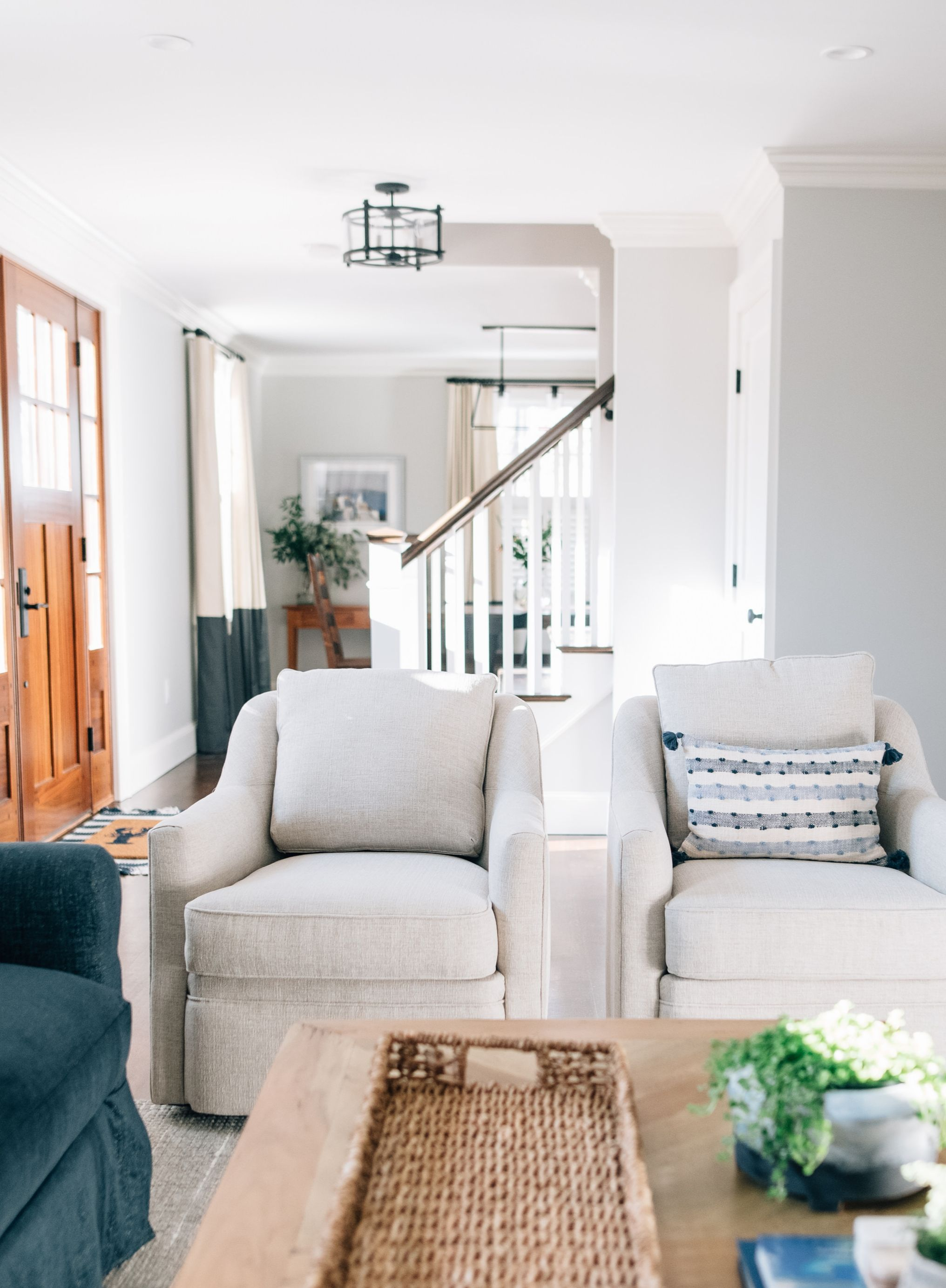 Living Room With Ivory Cream Off White Swivel Chairs And Blue Sofa And Long Rustic Reclaimed Table In 2020 White Swivel Chairs Grey Oak Reclaimed Table