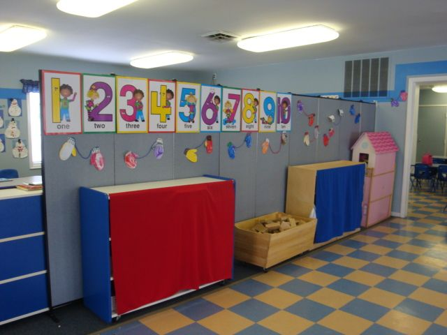 Daycare learning center uses portable walls to divide space teach ps building a classroom - Movable room divider ideas ...