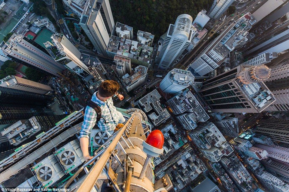 Daredevil Urban Climbers Reveal New Pictures From Dizzying Heights - Daredevil duo climb hong kongs buildings capture like youve never seen