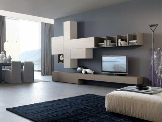 graue wandfarbe wohnwand modern lowboard hocker creme teppich - Wohnzimmer Design Wandfarbe Grau