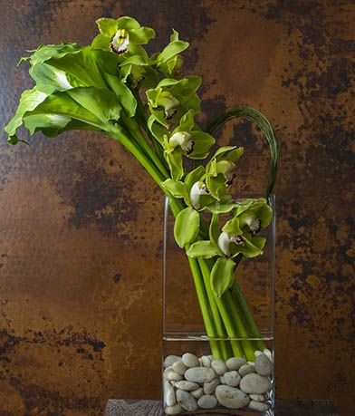 Green goddess callas and cymbidium orchids combine to create a look of modern simplicity – impressive in a home or office. www.donnaweaverphotography.com