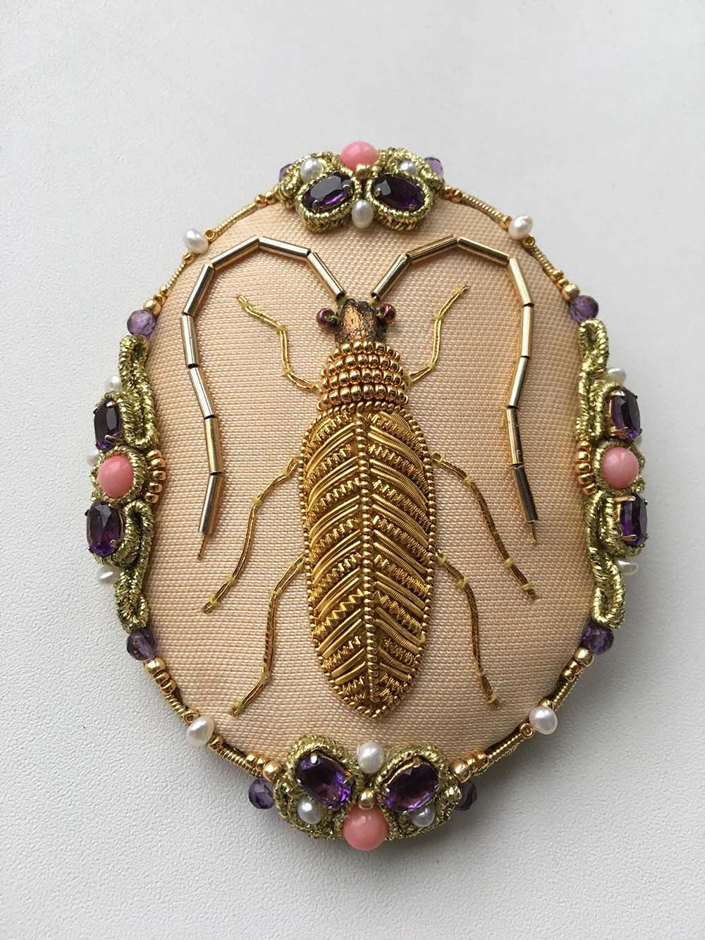 Goldwork embroidery beetle done by Larissa Borodich, design by Jane Nicholas. Brooch made by Olesya Bryutova.