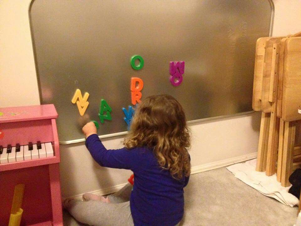 $11 oil pan from auto dept at walmart + Command strips = magnetic letter heaven! Shared by a mom in my Mom2Mom fb group